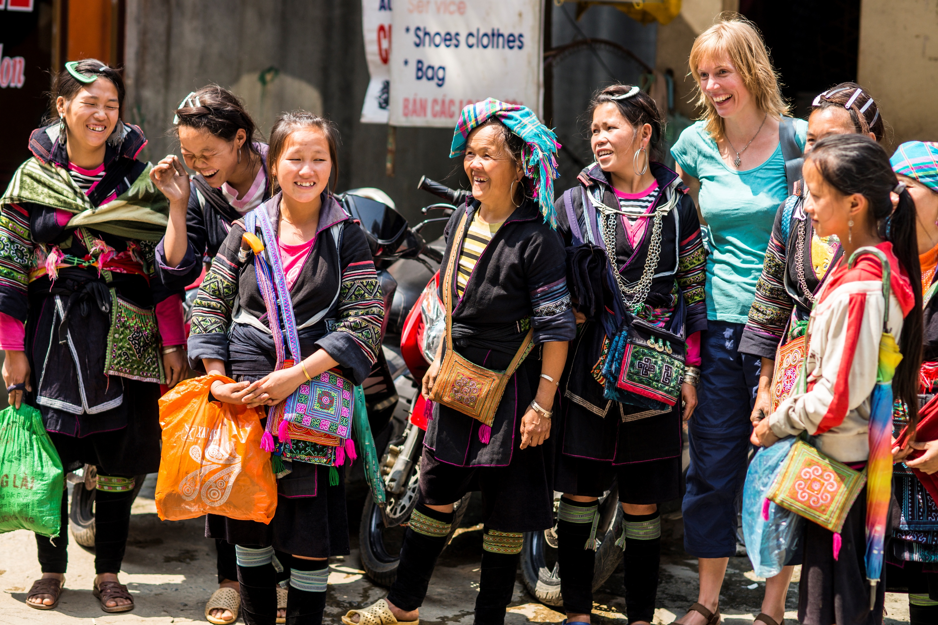 Foreign traveller with ethnic people in Sapa